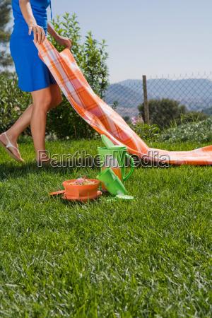 woman preparing picnic in park leg
