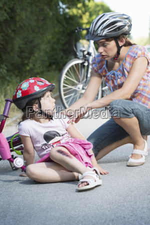 mother caring for daughter fallen off