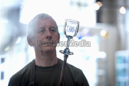 glassblower with complete drinking glass