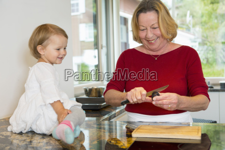 female toddler sitting on kitchen counter