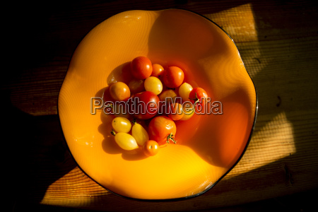 overhead view of tomatoes in orange