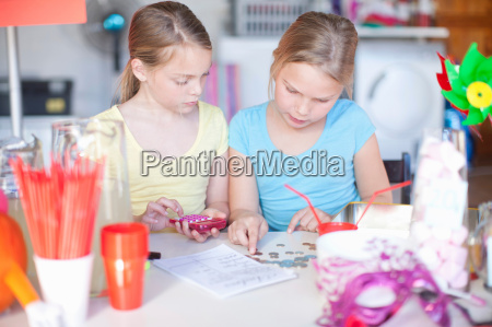 two young sisters checking stall profits