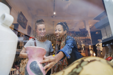 young woman shopping for pink vase