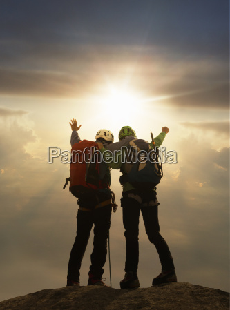 climbers exulting on mountain top at
