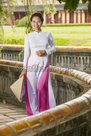 mid adult woman wearing ao dai