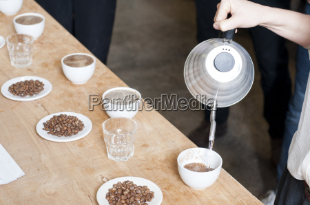 coffee seller pouring hot water into