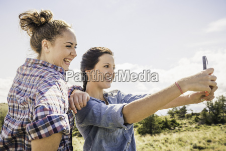 two young women taking selfie on