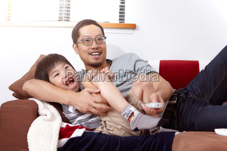 young modern chinese family of father