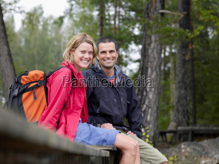 couple sitting on a dock smiling