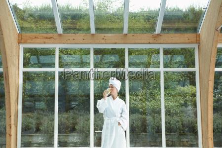 woman wearing robe by pool