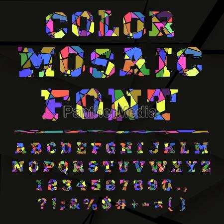 broken colored alphabet on a dark
