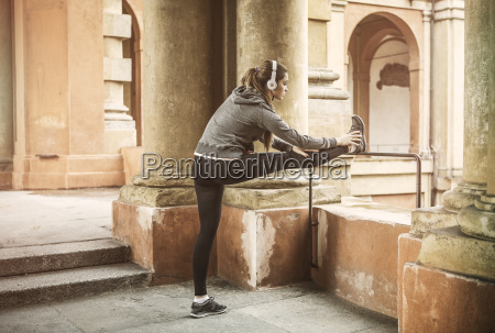 young woman wearing sports clothes and