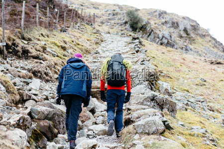 young couple hiking rear view honister