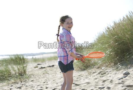 side view of girl holding orange