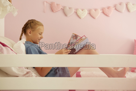 side view of girl sitting on