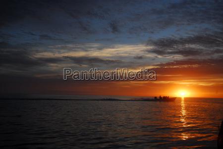 dramatic sky and sunrise over ocean