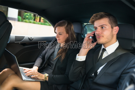 businessman and businesswoman in the car
