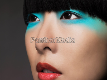 woman with turquoise eyeshadow