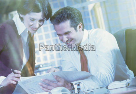 business people studying document