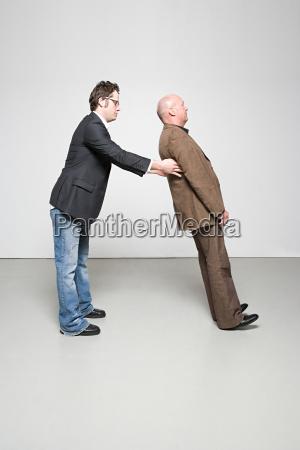 man catching man