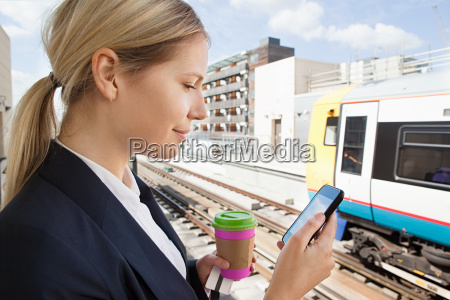 businesswoman with coffee and smart phone
