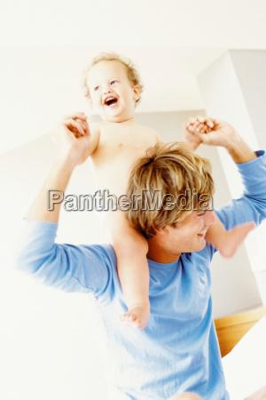 father giving a piggyback