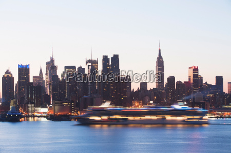 manhattan skyline and cruise boat at
