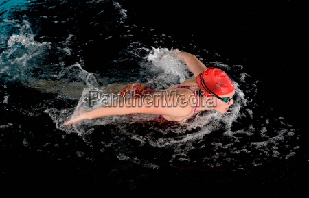 teenage girl doing butterfly stroke in