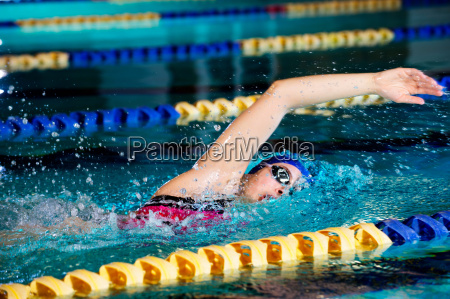 young woman doing front crawl in