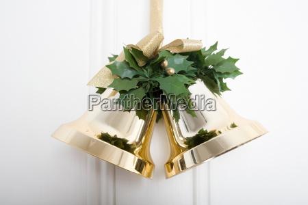 christmas bells hanging on a door