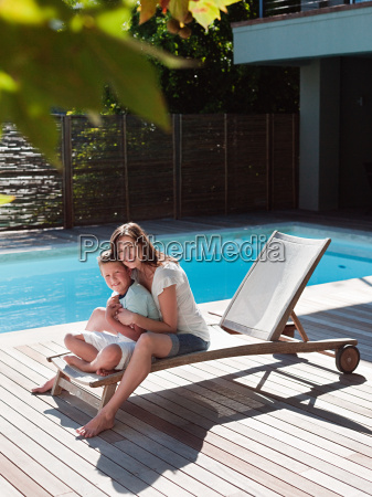 boy and mother on chair by