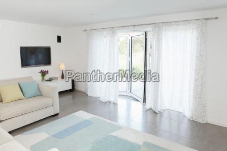 living room with glass door to
