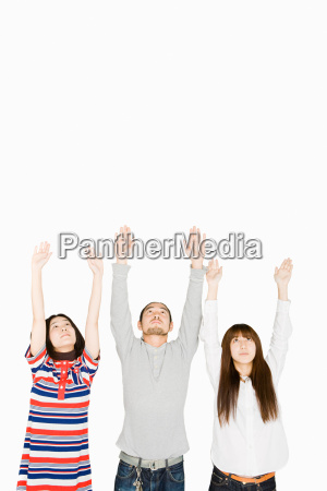 people with arms raised