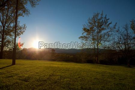 sunlight over rural landscape