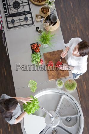women preparing salad