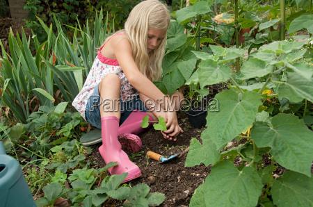 girl gardening in vegetable garden