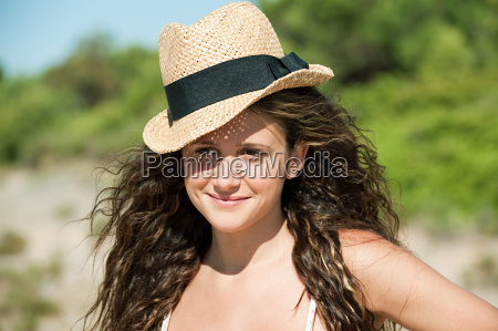 young woman wearing hat portrait
