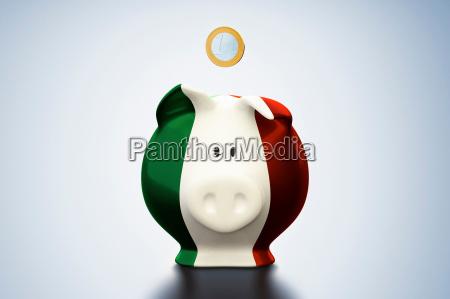 euro coin above italian flag piggy