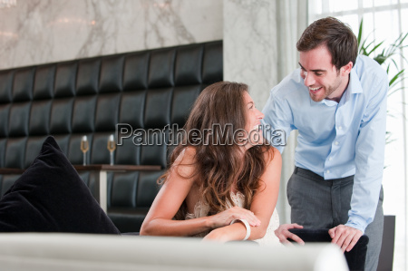 young couple laughing at dinner table