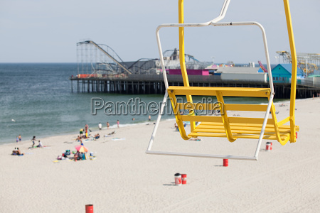 chair lift and beach at seaside