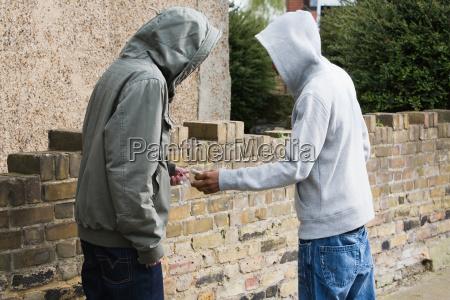 teenagers passing drugs