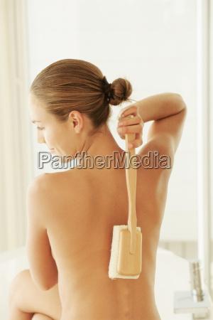 woman scrubbing back