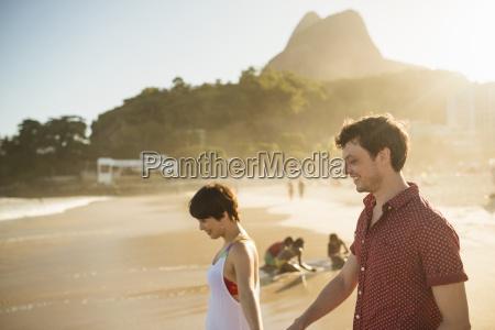 young couple enjoying sunset ipanema beach
