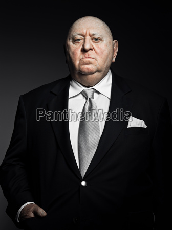 studio portrait of serious gangster