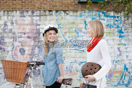 women on bicycles on city street