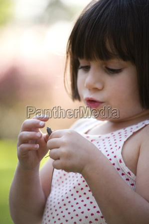 close up portrait of girl holding