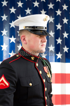 serviceman in dress blues by us