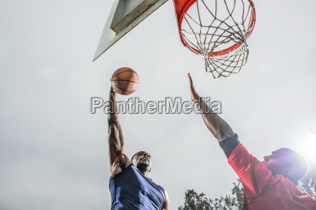 young basketball players jumping to score