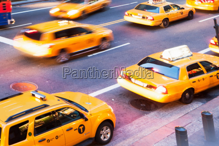 angular view of yellow cabs on