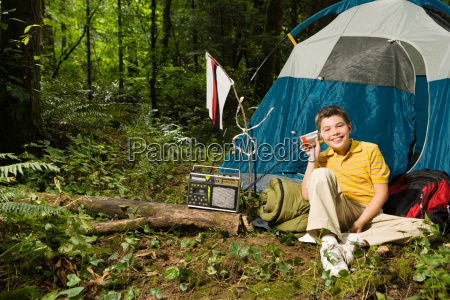boy at camp with radio
